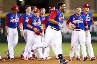 Audry Perez (10) of the Springfield Cardinals runs away from teammates after hitting a game winning base hit against the Corpus Christi Hooks at Hammons Field on August 13, 2011 in Springfield, Missouri. Springfield defeated Corpus Christi 8-7. (David Welker / Four Seam Images)