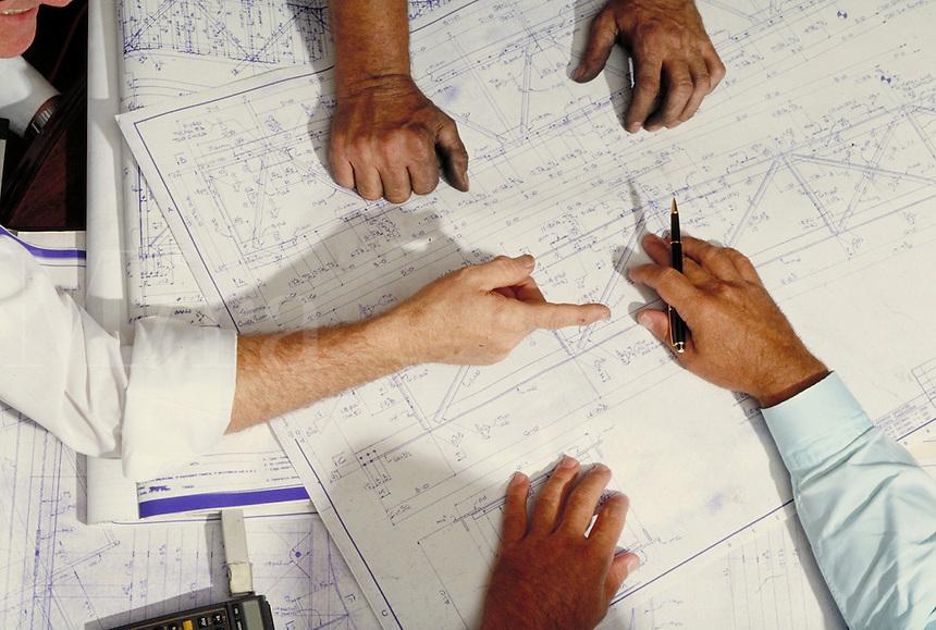 Hands over set of plans. Birmingham Alabama United States.