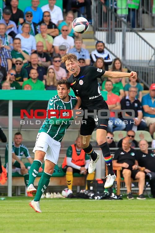 11.08.2019, Stadion Lohmühle, Luebeck, GER, DFB-Pokal, 1. Runde VFB Lübeck vs 1.FC St. Pauli<br /> <br /> DFB REGULATIONS PROHIBIT ANY USE OF PHOTOGRAPHS AS IMAGE SEQUENCES AND/OR QUASI-VIDEO.<br /> <br /> im Bild / picture shows<br /> Zweikampf/Kopfball. Kopfballduell zwischen Ahmet Arslan  (VfB Luebeck) und Marc Hornschuh (FC St. Pauli).<br /> <br /> Foto © nordphoto / Freund