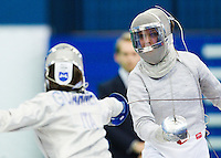 27 FEB 2011 - LONDON, GBR - Poland's Katarzyna Kedziora parries Italian Paola Guarneri's attack during the third place decider at fencing's England Cup team sabre tournament at  the National Sports Centre at Crystal Palace (PHOTO (C) NIGEL FARROW)
