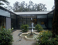 The inner atrium of the house has a quaterfoil pool and fountain in the Italian style