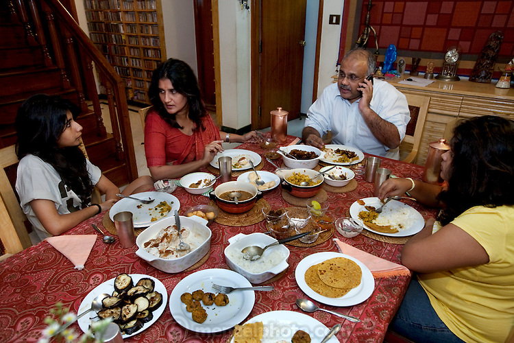 Millie Mitra (center in red top) eats dinner with her family at her home in Benson Town, Bangalore, India. (Millie Mitra is featured in the book What I Eat: Around the World in 80 Diets.) Millie, a vegan, has a thirst for alternative medicine and homeopathic healing, as well as a deep interest in how her diet affects her body. She has practiced Shivambu (sometimes spelled Sivambu), which is the drinking of one's own first morning urine (200 cc in her practice) as a curative and preventative measure, for over 15 years. Millie applies urine to her skin as well, for the same reasons. Her husband Abhik has tried Shivambu and she helped her children to practice it when they were young, but currently only Millie practices urine therapy.