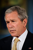 United States President George W. Bush, right, makes remarks to the press at the State Department, March 24, 2008 in Washington, DC. In his remarks the President thanked the employees of the State Department for their hard work. <br /> Credit: Ken Cedeno / Pool via CNP