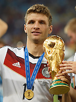Thomas Muller of Germany lifts the World Cup trophy after winning the 2014 final