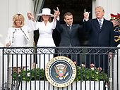 United States President Donald J. Trump, right, and first lady Melania Trump, left center, and President Emmanuel Macron of France, right center, and his wife, Brigitte Macron, left, pose for a group photo following an arrival ceremony on the South Lawn of the White House in Washington, DC on Tuesday, April 24, 2018.<br /> Credit: Ron Sachs / CNP