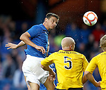 Lee McCulloch powers the ball home to open the scoring for Rangers in a huge spray of sweat as Falkirk fall in the cup
