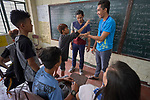 "Larren Jo ""LJ"" Bacilio (center), a teacher in the Alternative Learning System of the Kapatiran-Kaunlaran Foundation (KKFI), watches as students act out a lesson during a class in the Tondo neighborhood of Manila, Philippines. <br /> <br /> KKFI is supported by United Methodist Women."