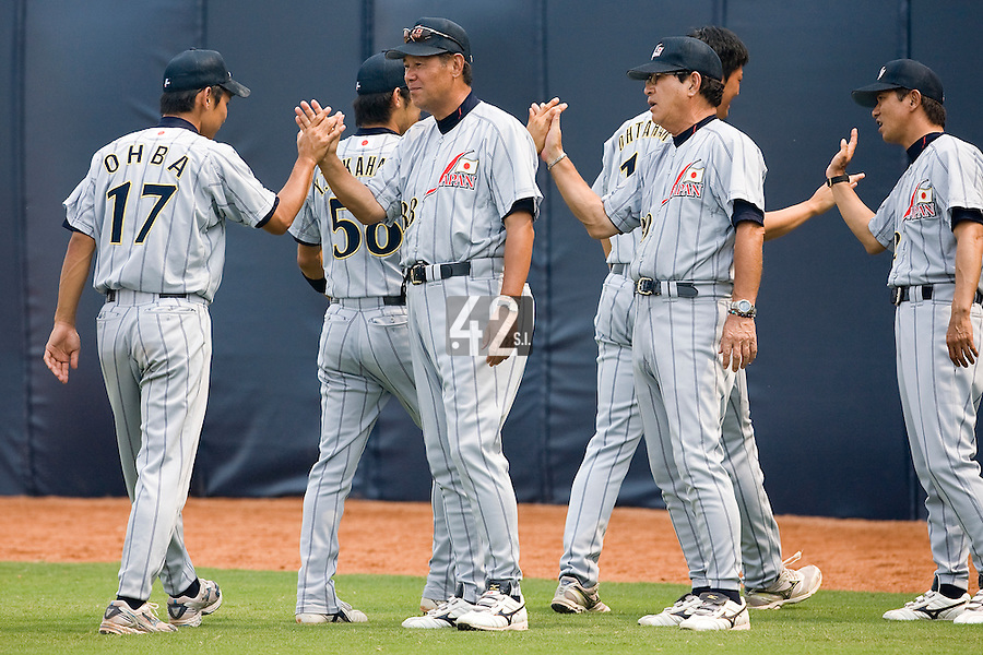 19 August 2007: Team Japan celebrate after the Japan 4-3 victory over France in the Good Luck Beijing International baseball tournament (olympic test event) at the Wukesong Baseball Field in Beijing, China.