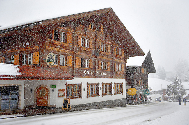 Grindelwald town with Hotel Steinbock  in the winter snow. Ski resort - Swiss Alps