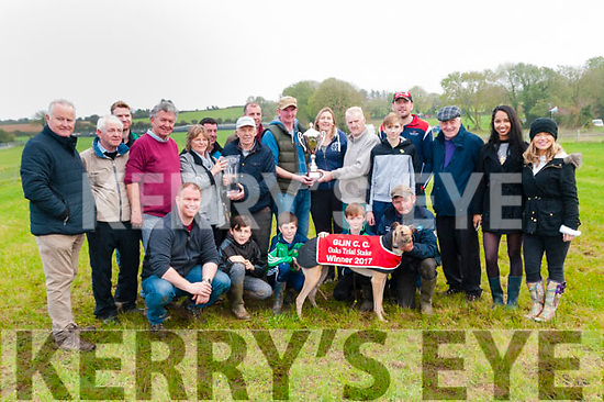 """Glin Coursing : Michael Sweeney presenting the Paddt Sweeney Memorial Oaks Trail Stake trophy to Tom & Trish Nolan, Abbeyfeale after their dgreyhound """"Silent Wonder"""" beat Ballyduff man Donal Lynch's """"Homestaed Model """" in the final."""