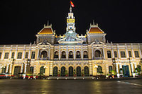 Ho Chi Minh City Hall was built in 1902-1908 in a French colonial style for the then city of Saigon and called Hotel de Ville de Saigon -  It was renamed after 1975 as Ho Chi Minh City People's Committee Hall. The building is Illuminated at night, though it is not opened to the public.  Saigon Town Hall was completed in 1908. Its French builders imitated town halls in Europe.  Once the Communist government took over in 1975 the building took on its present name.  Its French-Colonial architecture and cream and yellow coloring, not to mention its iconic statue of Ho Chi Minh himself, make it a symbol of Saigon..