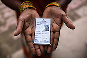 A woman holds the only photograph of Ravina Khatoon Shivpur Hariyya village in Raxaul district of Bihar. Ravina Khatoon died few days after giving birth to Muniya.