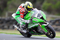 PHILLIP ISLAND, 22 FEBRUARY - Roberto Rolfo (ITA) riding the Kawasaki ZX-10R (44) of the Team Pedercini at day two of the testing session prior to round one of the 2011 FIM Superbike World Championship at Phillip Island, Australia. (Photo Sydney Low / syd-low.com)