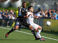 Victor Bernardez of Earthquakes fights for the ball against Davide Chiumiento of Whitecaps during the game at Buck Shaw Stadium in Santa Clara, California on April 7th, 2012.  San Jose Earthquakes defeated Vancouver Whitecaps, 3-1.