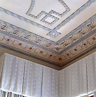 Detail of the decorative hand-painted frieze that surrounds the bedroom walls