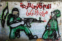 """""""The blood is the law of this period"""" says a graffiti signed by Military wing of the Islamic Jihad, the Al Quds Brigades, in the """"Beach refugee camp"""", in Gaza strip, June 9, 2004. Photo by Quique Kierszenbaum"""