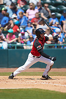 Tyler Depreta-Johnson (2) of the Hickory Crawdads follows through on his swing against the Charleston RiverDogs at L.P. Frans Stadium on May 13, 2019 in Hickory, North Carolina. The Crawdads defeated the RiverDogs 7-5. (Brian Westerholt/Four Seam Images)