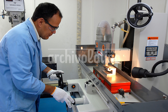 The laboratory  of Venezuelan state owned company PDVSA  where techs analyze  soil plaques to decide where to explore for  new oil location. Exploring new oil sources is a complex and very costly field of the oil industry.