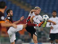 AS Roma's Miralem Pjanic fight for the ball with Leverkusen's Jonathan Tah N during the Champions League Group E soccer match between As Roma and  Bayer Leverkusen at the Olympic Stadium in Rome, November 04 2015