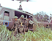 """Quang Tri, Vietnam - October 13, 1968 -- Members of Company """"A"""", Second Batallion, 8th Calvary, First Calvary Division, jump from an UH-1D helicopter in the mountainous area located approximately 10 km from Quang Tri, Vietnam on October 13, 1968 to search for a bunker complex..Credit: Ronald Delaurier - U.S. Army via CNP"""