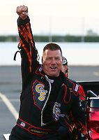 Feb 13, 2016; Pomona, CA, USA; NHRA funny car driver Jim Campbell reacts as he celebrates qualifying for his first career race during the Winternationals at Auto Club Raceway at Pomona. Mandatory Credit: Mark J. Rebilas-USA TODAY Sports