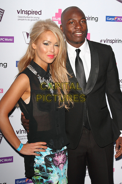 Katie Piper & Eddie Kadi.Vinspired Awards, The Roundhouse, Chalk Farm, London, England..March 26th 2013.half length black sleeveless sheer blouse top see through thru bra white green blue silver necklace pattern skirt print suit shirt hand on hip.CAP/ROS.©Steve Ross/Capital Pictures.