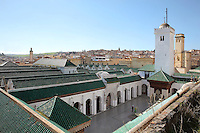 The Kairaouine Mosque, rebuilt in the 10th century under Abd Er Rahman III, Caliph of Cordoba, and in the 12th century under the Almoravids, Fes, Fes-Boulemane, Northern Morocco. The mosque was founded in 857 by Fatima al-Fihri, daughter of a wealthy refugee from the holy city of Kairouan in Tunisia, who vowed to spend her money on a mosque for the Tunisian community in Fes. It is the earliest Islamic building in Fes and the holiest mosque in Morocco.  The medina of Fes was listed as a UNESCO World Heritage Site in 1981. Picture by Manuel Cohen