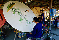 Painting sun umbrellas, Chaing Mai, Thailand.