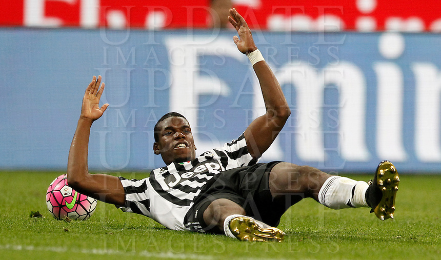 Calcio, Serie A: Milan vs Juventus. Milano, stadio San Siro, 9 aprile 2016. <br /> Juventus&rsquo; Paul Pogba reacts during the Italian Serie A football match between AC Milan and Juventus at Milan's San Siro stadium, 9 April 2016.<br /> UPDATE IMAGES PRESS/Isabella Bonotto
