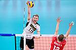 16.09.2019, Lotto Arena, Antwerpen<br />Volleyball, Europameisterschaft, Deutschland (GER) vs. …sterreich / Oesterreich (AUT)<br /><br />Angriff Simon Hirsch (#13 GER) - Block Alexander Berger (#12 AUT)<br /><br />  Foto © nordphoto / Kurth