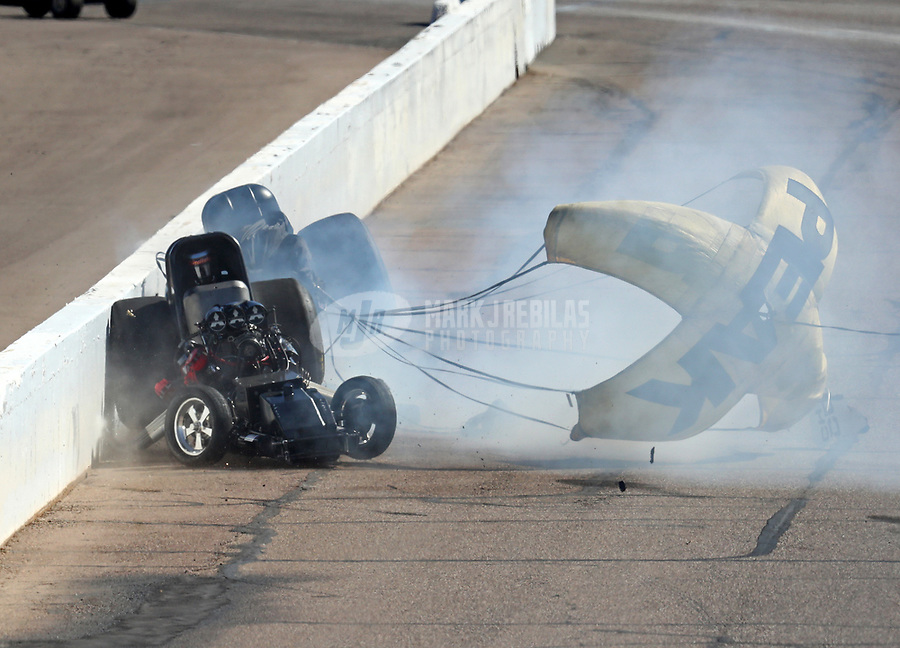 Feb 25, 2018; Chandler, AZ, USA; NHRA funny car driver Jonnie Lindberg (front) crashes with John Force during the Arizona Nationals at Wild Horse Pass Motorsports Park. Mandatory Credit: Mark J. Rebilas-USA TODAY Sports