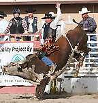 Charles Porter of Reno competes in the Bull Riding event.  Photo by Tom Smedes.