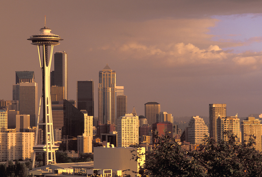 Seattle skyline under stormy skies at sunset, Seattle, Washington