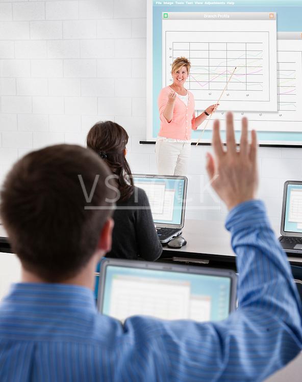USA, Illinois, Metamora, Woman teaching adult computer class