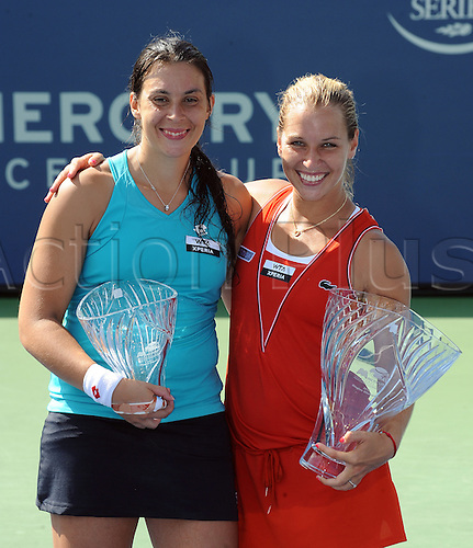 22.07.2012. La Costa, California, USA.  Marion Bartoli (FRA) and Dominika Cibulkova (SVK) with their trophies after Cibulkova defeated Bartoli in a finals match to win the Mercury Insurance Open at the La Costa Resort and Spa.