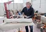 Sculptors working on local Portland stone in a community studio space on the Isle of Portland, Dorset, England