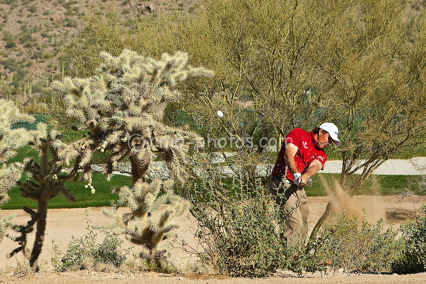 Feb 26, 2009; Marana, AZ, USA; Phil Mickelson (USA) hits out of the desert on the 2nd hole during the second round of the World Golf Championships-Accenture Match Play Championship at the Ritz-Carlton Golf Club, Dove Mountain.