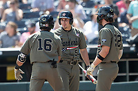 Vanderbilt Commodores outfielder JJ Bleday (51) greets teammate Austin Martin (16) at the plate after his second home run during Game 3 of the NCAA College World Series against the Louisville Cardinals on June 16, 2019 at TD Ameritrade Park in Omaha, Nebraska. Vanderbilt defeated Louisville 3-1. (Andrew Woolley/Four Seam Images)