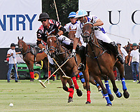 """WELLINGTON, FL - APRIL 25:  Adolfo Cambiaso of Valiente (white jersey) and Juan """"Jota"""" Chavanne of Orchard Hill battle for the ball, as Valiente defeats Orchard Hill 13-12, in OT,  in the US Open Polo Championship Final, to win the U. S. Polo Triple Crown, at the International Polo Club Palm Beach, on April 25, 2017 in Wellington, Florida. (Photo by Liz Lamont/Eclipse Sportswire/Getty Images)"""