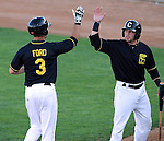 SIOUX FALLS, SD - JUNE 19 Shelby Ford #3 from the Sioux Falls Canaries gets a high five from teammate Kevin Dultz #21 after a two run home run against the Amarillo Sox in the third inning Thursday night at the Sioux Falls Stadium. (Photo by Dave Eggen/Inertia)