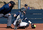 March 7, 2012:   Nevada Wolf Pack catcher Ashley Butera digs a ball out of the dirt against the Sacramento State Hornets during their NCAA softball game played at Christina M. Hixson Softball Park on Wednesday in Reno, Nevada.