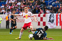 Dax McCarty (11) of the New York Red Bulls and Amobi Okugo (14) of the Philadelphia Union. The New York Red Bulls defeated the Philadelphia Union 2-1 during a Major League Soccer (MLS) match at Red Bull Arena in Harrison, NJ, on March 30, 2013.