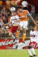 Chicago Fire midfielder Logan Pause (7) and Houston Dynamo forward Brian Ching (25) go up for the header.  Houston Dynamo defeated Chicago Fire 3-2  at Robertson Stadium in Houston, TX on August 9, 2009.