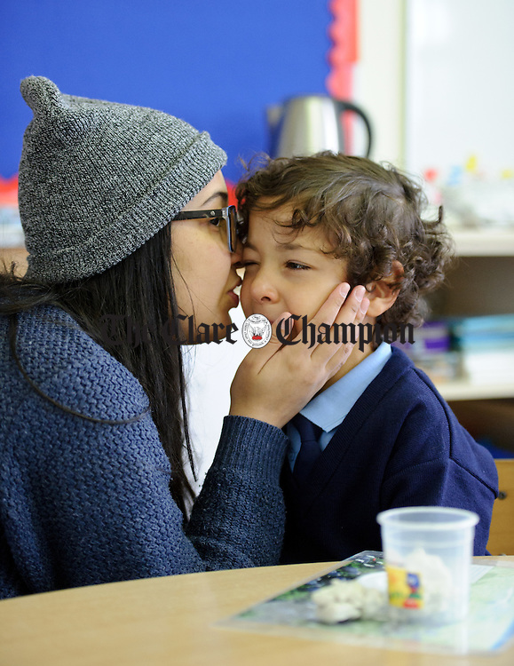 Nayara Dias comforts her little brother Nickolas Dias   on his first day of school at Boston NS. Photograph by John Kelly.