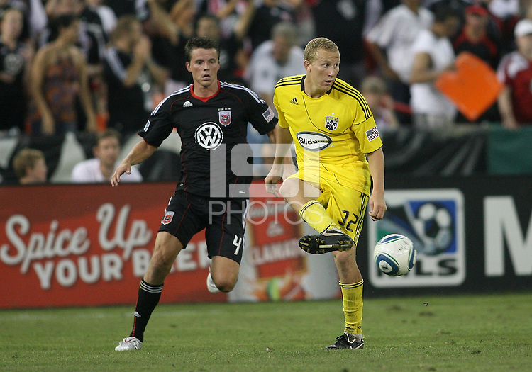 Marc Burch #4 of D.C. United comes up behind Steven Lenhart #32 of the Columbus Crew during a US Open Cup semi final match at RFK Stadium on September 1 2010, in Washington DC. Columbus won 2-1 aet.