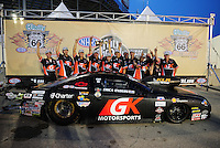 Jul. 1, 2012; Joliet, IL, USA: NHRA  pro stock driver Erica Enders and crew celebrate after winning the Route 66 Nationals at Route 66 Raceway. Mandatory Credit: Mark J. Rebilas-