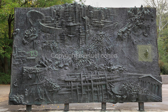 Relief of battle from the Monument to the Spanish Civil War or Denkmal der Spanienkampfer, designed 1968 by Fritz Cremer, in the Volkspark Friedrichshain, Berlin, Germany. This monument commemorates the German members of the International Brigades who fought with the Republicans in the Spanish Civil War. Picture by Manuel Cohen