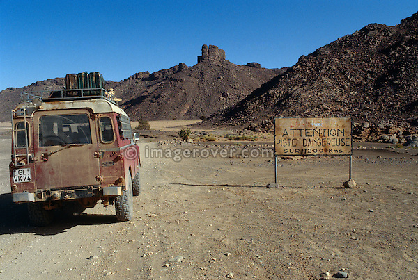Algeria, Africa, Sahara. Series 3 Land Rover hardtop entering a 200km long dangerous piste on the journey form Tamanrasset to Djanet in southern Algeria. --- Property release available. Automotive trademarks are the property of the trademark holder, authorization may be needed for some uses.