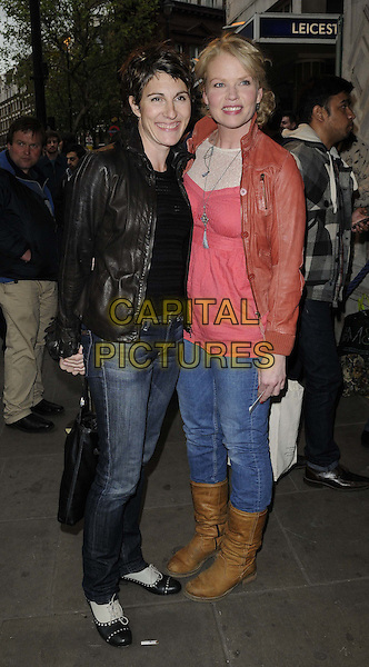 Tamsin Greig & Sara Crowe.attended the 'Abigail's Party' press night, Wyndhams Theatre, Charing Cross Rd., London, England, UK, May 18th 2012..full length black leather jacket red jeans  brown boots brogues .CAP/CAN.©Can Nguyen/Capital Pictures.