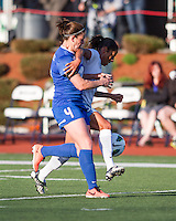 Chicago Red Stars forward Maribel Domingues (9) fends off a tackle from Boston Breakers defender Cat Whitehill (4).  In a National Women's Soccer League Elite (NWSL) match, the Boston Breakers defeated  Chicago Red Stars 4-1, at the Dilboy Stadium on May 4, 2013.